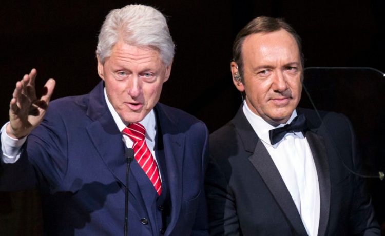 Former U.S. President Bill Clinton speaks next to actor Kevin Spacey during the Rainforest Fund's 25th anniversary benefit concert in New York April 17, 2014. REUTERS/Lucas Jackson