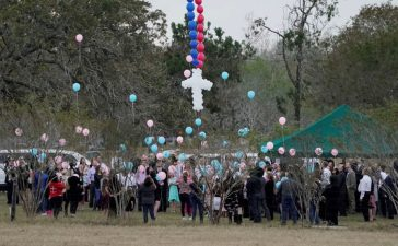 Balloons are released during a funeral service for six members of the Holcombe family and 3 members of the Hill family, victims of the Sutherland Springs Baptist church shooting, in Sutherland Springs, Texas, U.S. November 15, 2017. REUTERS/Darren Abate