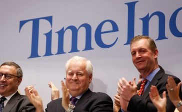 Time Inc. CEO Joe Ripp (2nd L) claps after ringing the bell to open trading at the New York Stock Exchange in New York June 9, 2014. Time Inc, the magazine company that is home to People, Sports Illustrated and Time, saw its shares fall lower on the New York Stock Exchange on Monday in its first trading session following a spinoff from its parent, Time Warner Inc. REUTERS/Carlo Allegri
