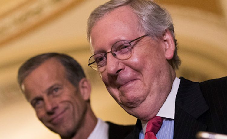 WASHINGTON, DC - OCTOBER 24: Senate Majority Leader Mitch McConnell (R-KY) smiles after addressing reporters following a lunch with Senate Republicans and President Donald Trump, on Capitol Hill, October 24, 2017 in Washington, DC. Trump joined the senators to talk about upcoming legislation, including the proposed GOP tax cuts and reform. (Photo by Drew Angerer/Getty Images)