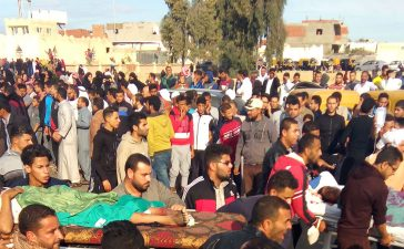 Egyptians carry victims on stretchers following a gun and bombing attack on the Rawda mosque near the North Sinai provincial capital of El-Arish on November 24, 2017. Armed attackers killed at least 235 worshippers in a bomb and gun assault on the packed mosque in Egypt's restive North Sinai province, in the country's deadliest attack in recent memory. /AFP/Getty Images
