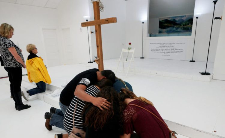 People pray in the First Baptist Church of Sutherland Springs where 26 people were killed in a shooting attack last week, as the church was opened to the public as a memorial to those killed, in Sutherland Springs, Texas, U.S. November 12, 2017. REUTERS/Rick Wilking