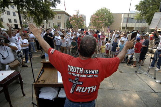 JACKSON, MS - JULY 17: The Rev. Philip Benham of Concord, North Carolina, director of Operation Save America, leads a demonstration to close the state's only abortion clinic on the capital steps July 17, 2006 in Jackson, Mississippi. The demonstration drew hundreds of pro-life and pro-choice protestors from around the country. (Photo by Marianne Todd/Getty Images)