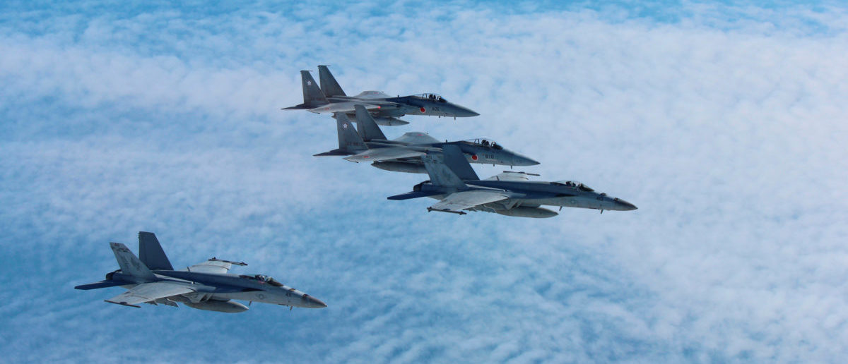 Image result for Photo, Japan's Self-Defense Force's F-15 fighter jets (top and 2nd from top) conduct an air exercise with U.S. Navy F/A 18 Hornet aircrafts in the skies above the Sea of Japan, Japan