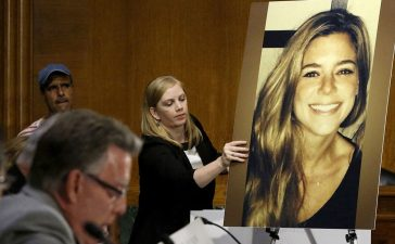 A photo of murder victim Kate Steinle (R), allegedly killed at the hands of an undocumented immigrant, is placed on an easel as her father Jim Steinle (2nd L) prepares to testify about her murder during a hearing of the Senate Judiciary Committee on U.S. immigration enforcement policies, on Capitol Hill in Washington, DC, U.S. on July 21, 2015. REUTERS/Jonathan Ernst/File Photo
