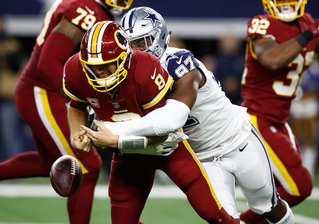 ARLINGTON, TX - NOVEMBER 30: Kirk Cousins #8 of the Washington Redskins fumbles the ball after a hit by Taco Charlton #97 of the Dallas Cowboys in the second quarter of a football game at AT&T Stadium on November 30, 2017 in Arlington, Texas. (Photo by Wesley Hitt/Getty Images)