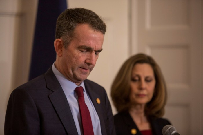 Virginia Governor Ralph Northam, accompanied by his wife Pamela Northam announces he will not resign during a news conference in Richmond