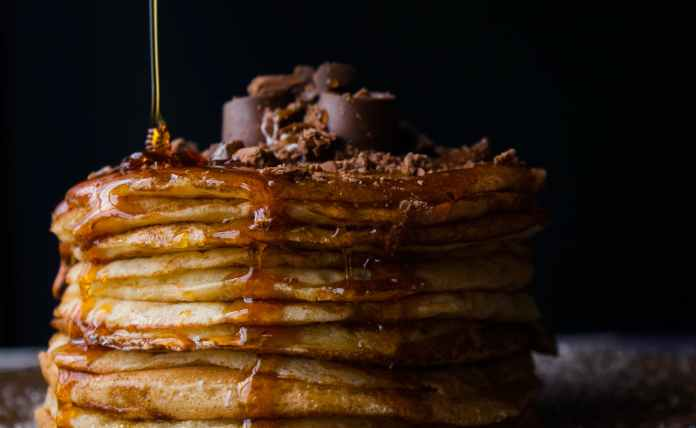 pile of pancake with honey
