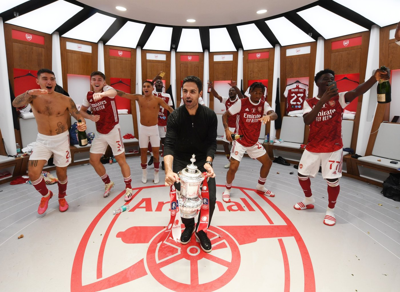 Superb dressing room shot as Mikel Arteta and players celebrate FA Cup win