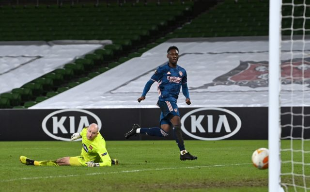 DUBLIN, IRELAND: Folarin Balogun of Arsenal scores their sides fourth goal past Gary Rogers of Dundalk during the UEFA Europa League Group B stage match between Dundalk FC and Arsenal FC at Aviva Stadium on December 10, 2020. (Photo by Charles McQuillan/Getty Images)