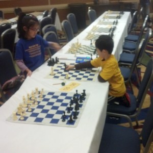 Allyson Lu proudly conquers her opponent while wearing a blue MSJE team shirt.