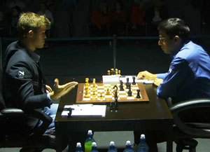 Magnus Carlsen and Viswanathan Anand at the finish of Game 9 from the 2014 FIDE World Chess Championship Match.