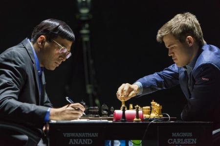 Magnus Carlsen (white) vs Viswanathan Anand (black) photo: http://www.sochi2014.fide.com/