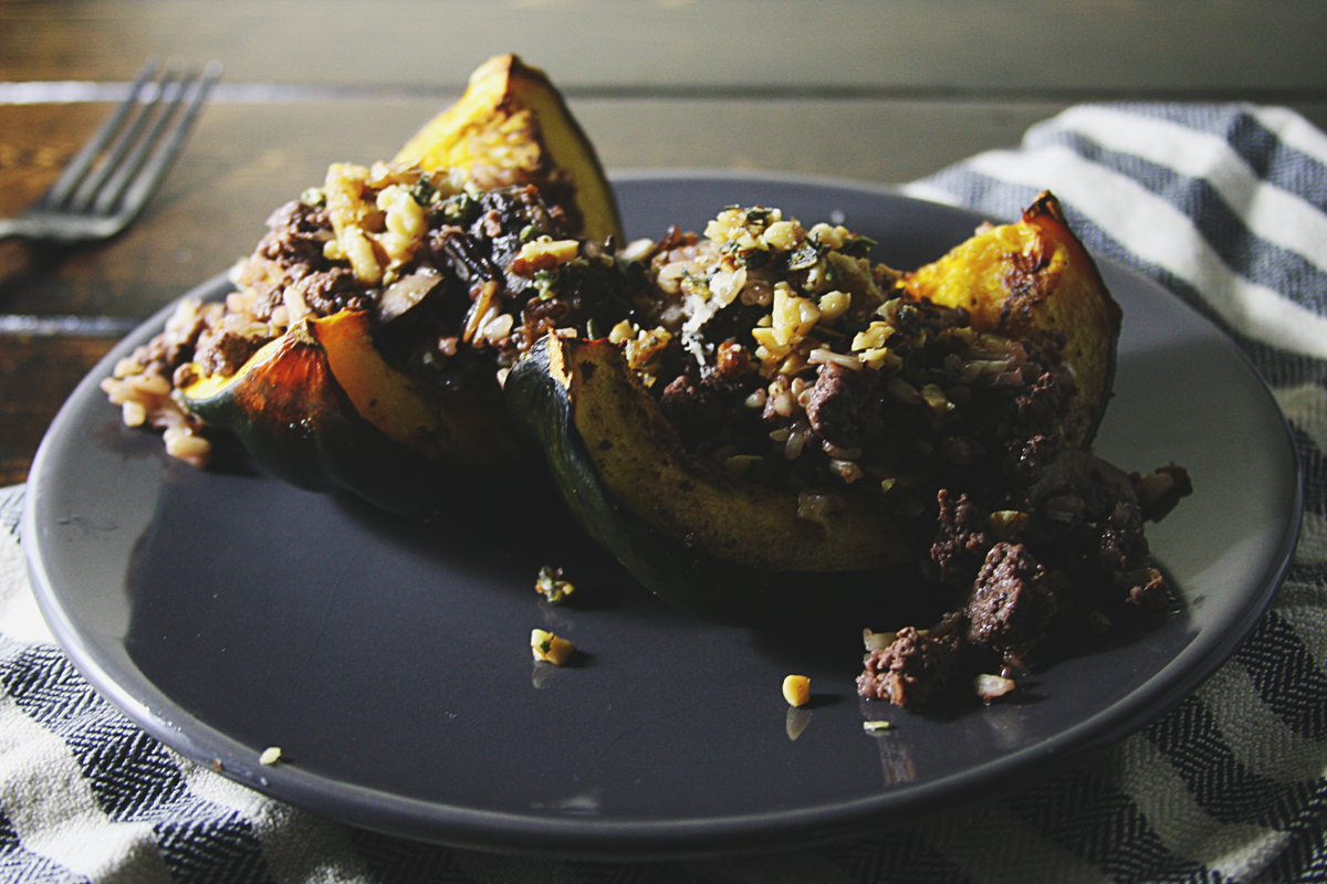 Wild Rice Mushroom Venison Stuffed Acorn Squash with Sage Walnut Gremolata