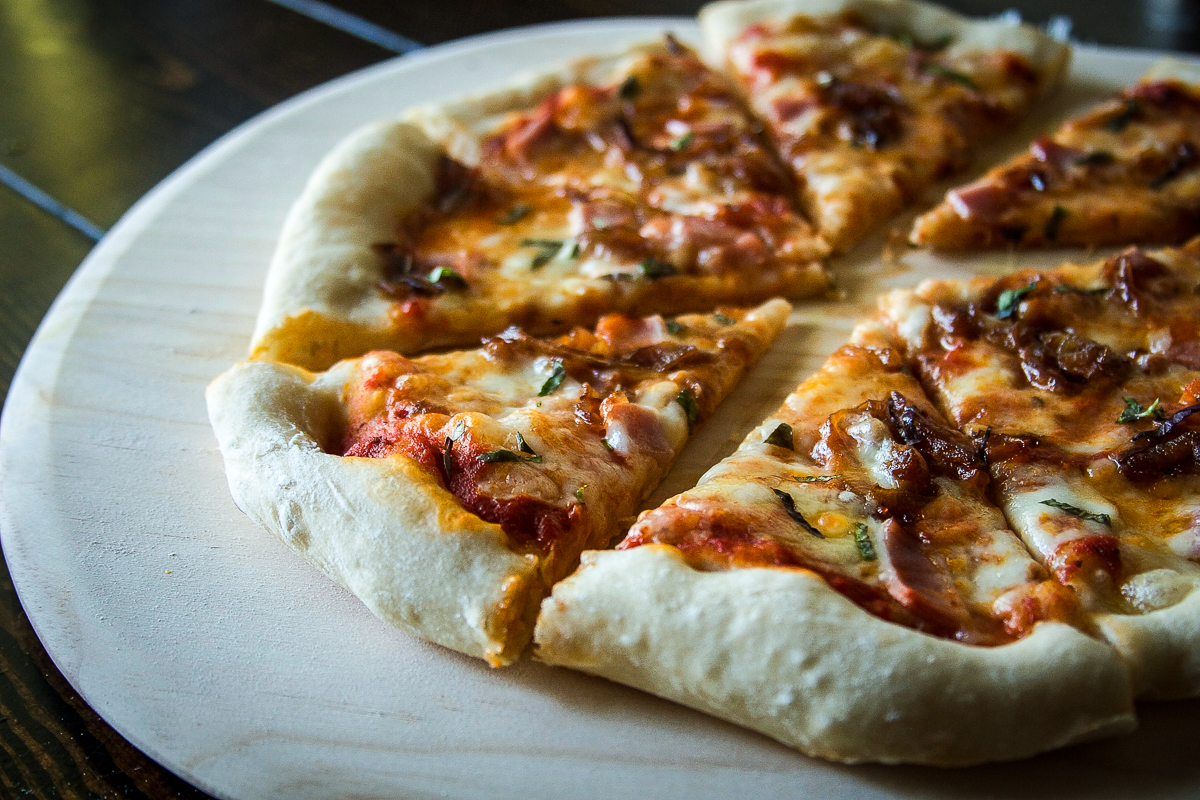 Caramelized Onion Pizza with Canadian Bacon and Swiss Cheese