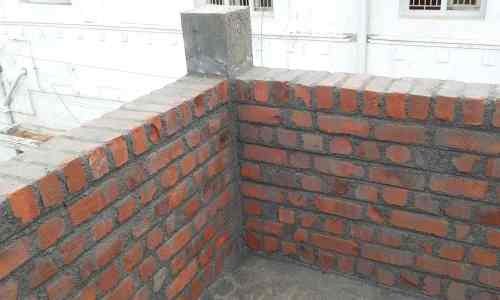 Solid parapet wall