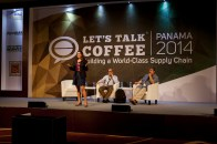 Leslie Joesphs of the Wall Street Journal speaks during the lecture 'Making Sense of Today's Coffee Market. Seated: (right) Ric Rhinehart, SCAA and (left) Carlos Brando, P&A International Marketing