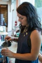 US Barista Champ Laila Ghambari pours a latte during a Coffee Break