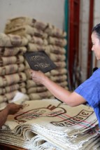 Coffee Bags being screened at delosAndes Coffee Cooperative. Photo by Mark Shimahara.