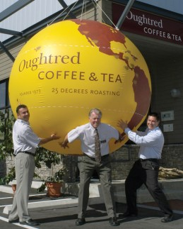 From left: John Jr., John Sr. and Michael Oughtred, at the opening of the company's new head office in Victoria, British Columbia, 2007.