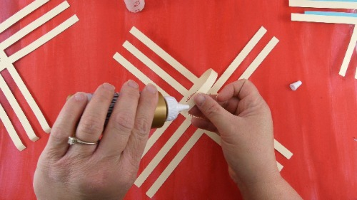 Use tacky glue to glue the ends of the 3D paper snowflake together