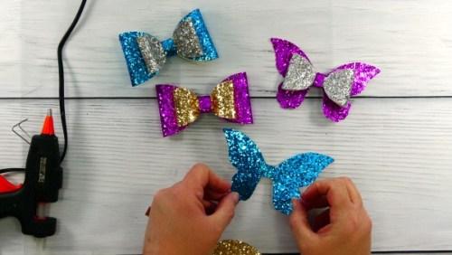 Base of glitter butterfly hair bow cut with Cricut
