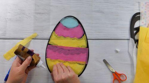 Glue Tissue paper to the back of easter egg suncatcher