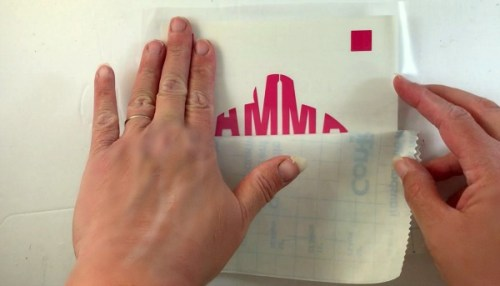 Apply transfer tape to your first layer of vinyl for layering.