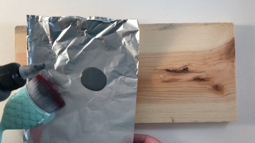 Distressing new wood with a makeup bruch