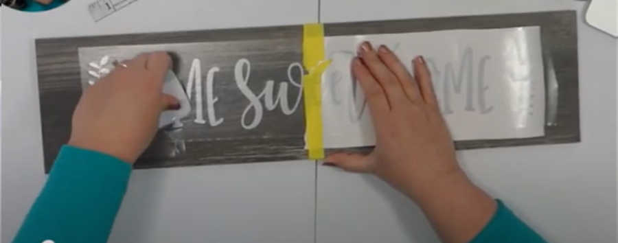 Rub the vinyl decal down so it sticks to your project