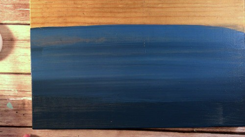 two shades of blue paint blended for an ombre sign.