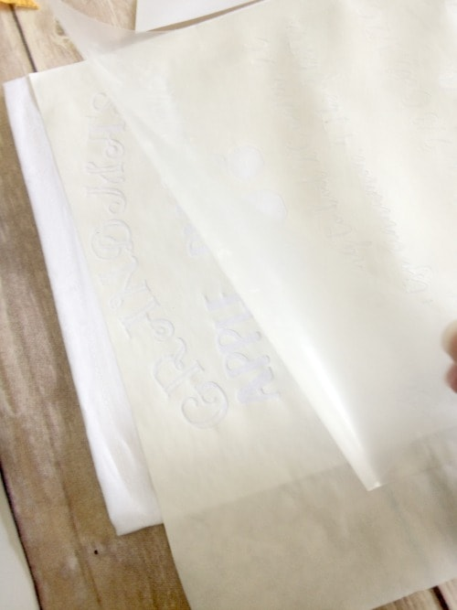 remove the heat transfer tape after the freezer paper stencil has bonded