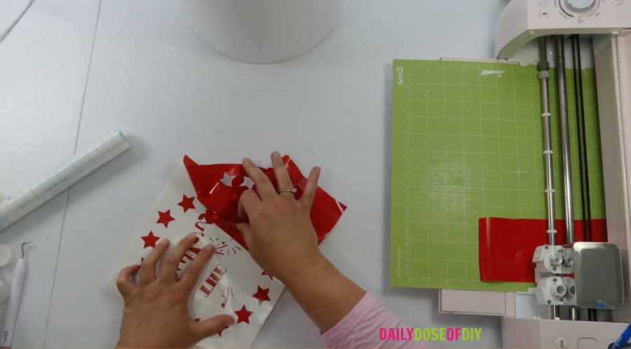 remove the extra vinyl after your desing is cut with a Cricut weeding tool