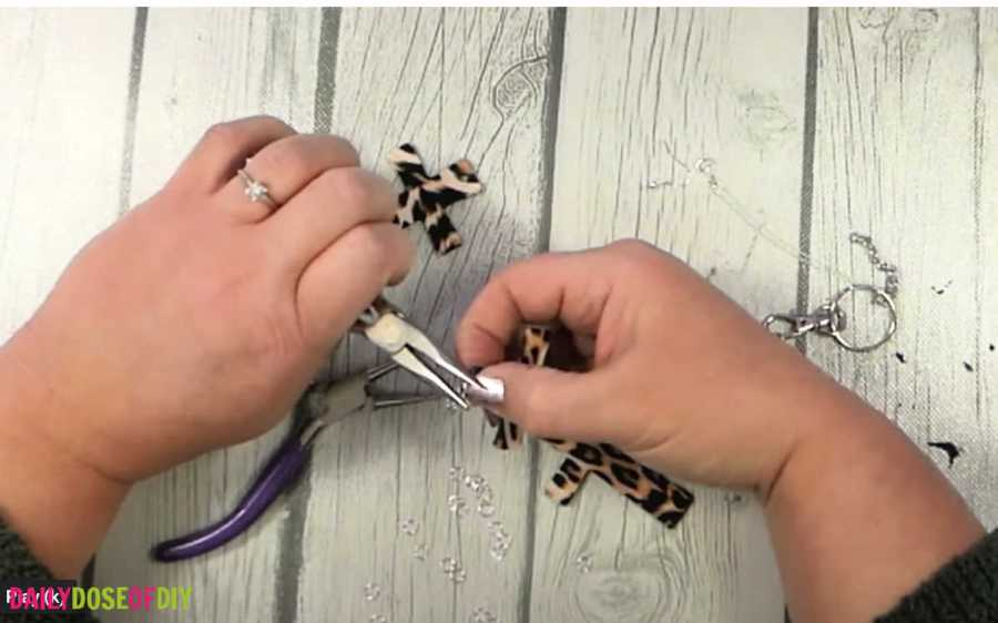 Use pliers to close the jump rings on the wooden earrings