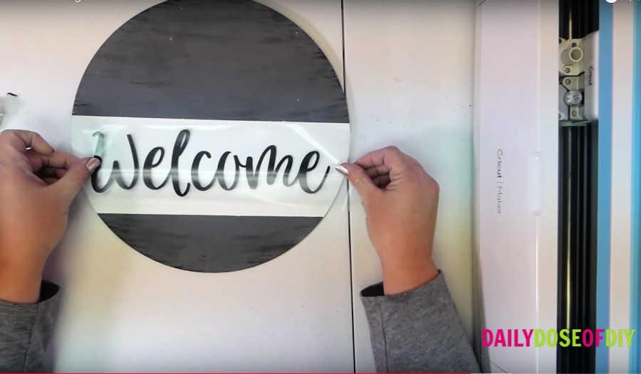 apply vinyl to the door hanger