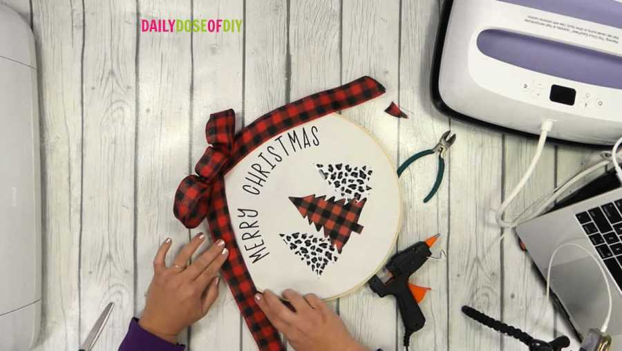 glue buffalo plaid ribbon to the edges of the embroidery hoop