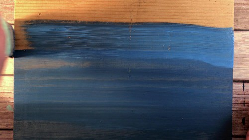 Blending the third shade of blue for an ombre painted sign