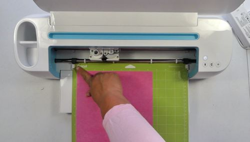 Loading paper into a Cricut cutiing machine