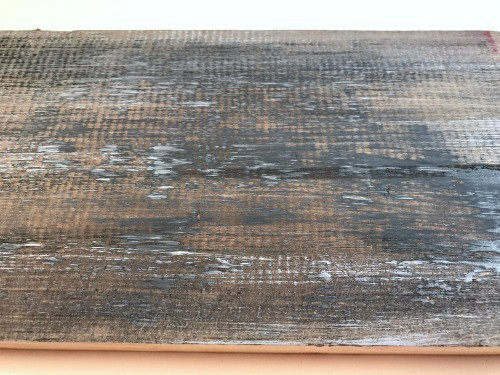 Wood that has been distressed with paint