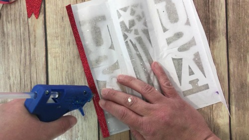 glue the ends of the patriotic lantern together.