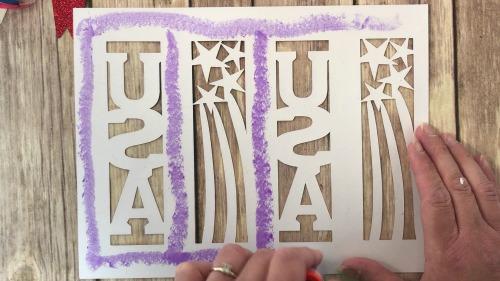 Glueing tissue paper on the DIY patriotic lantern