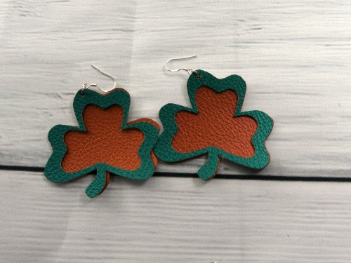 Faux leather shamrock earrings made with Cricut