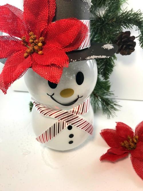 DIY snowman hat on snowman globe