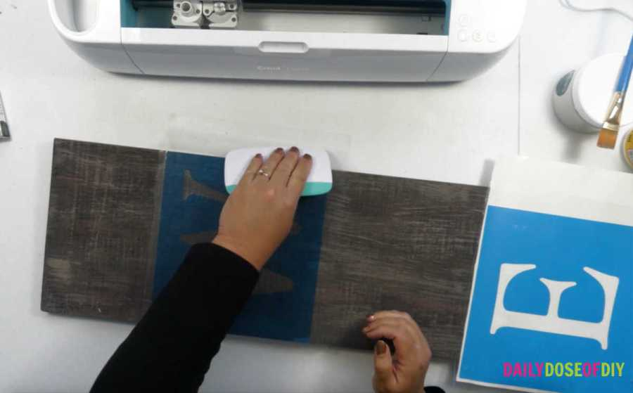 Burnish down the stencil to the vertical welcome sign