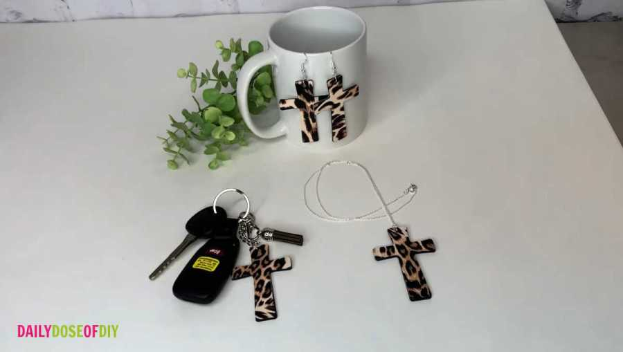 finished wooden cross accessories displayed on a white table