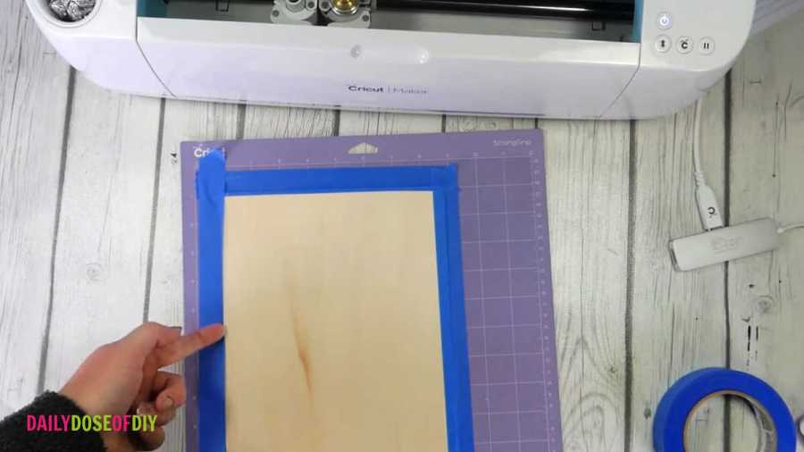 tape your wood to your mat to ensure it doesn't move during the cut