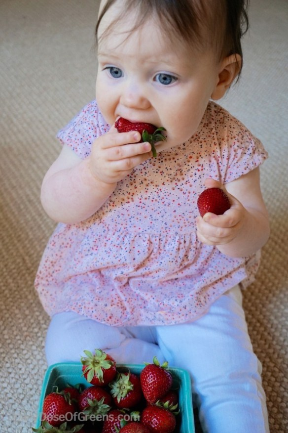 Abby eating strawberries