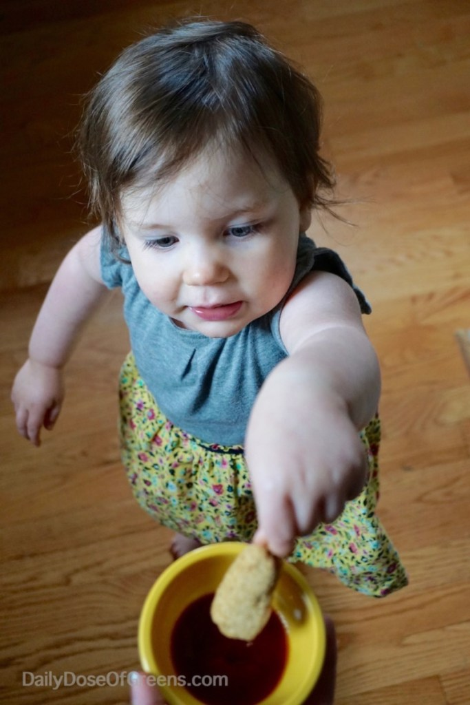 Abby dipping corn dog