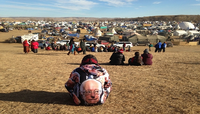 Protesters gather at an encampment on Saturday, Nov. 26, 2016, a day after tribal leaders received a letter from the U.S. Army Corps of Engineers that told them the federal land would be closed to the public on Dec. 5, near Cannon Ball, N.D. The protesters said Saturday that they do not plan to leave and will continue to oppose construction of the Dakota Access oil pipeline. James MacPherson/AP photo