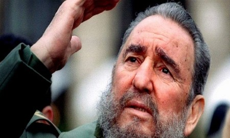 Cuba's President Fidel Castro gestures during a tour of Paris in this March 15, 1995 file photo. REUTERS/Charles Platiau/Files